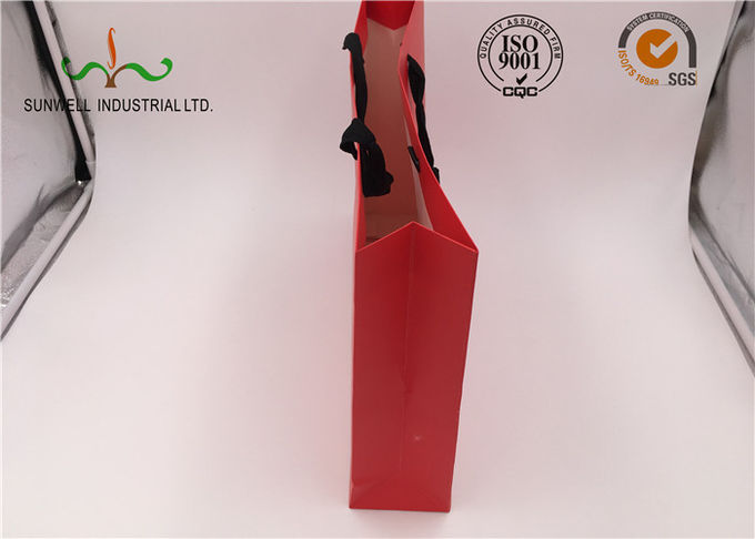 Red Coated Paper Printed Gift Bags With Handles For Cosmetics Packaging